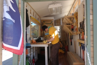 Evan working in the tiny workshop