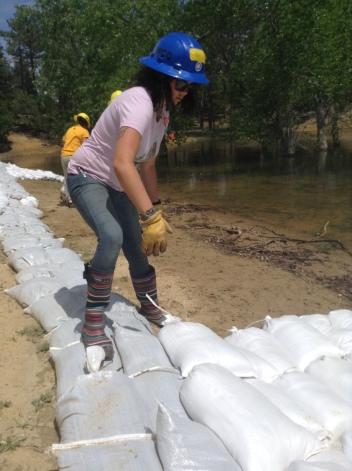 Madison Williams placing sandbags