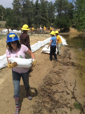 Madison in the front as they build a wall of sandbags