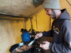 2011 - Now WCC program director Patrick Harrington prepares some early morning breakfast on a Devon Energy project
