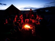 2011 - WCC crew and Devon Energy enjoy some time together around the fire after a long day of work together.