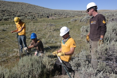 2015 - WCC staff and crews work on a fencing project with the Lander BLM, sponsored by Devon Energy